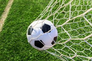5659199-soccer-ball-in-goal-net